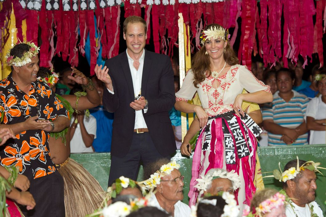 Prince William, Duke of Cambridge and Catherine, Duchess of Cambridge dance with the ladies at the Vaiku Falekaupule for an entertainment programme on September 18, 2012 in Tuvalu.