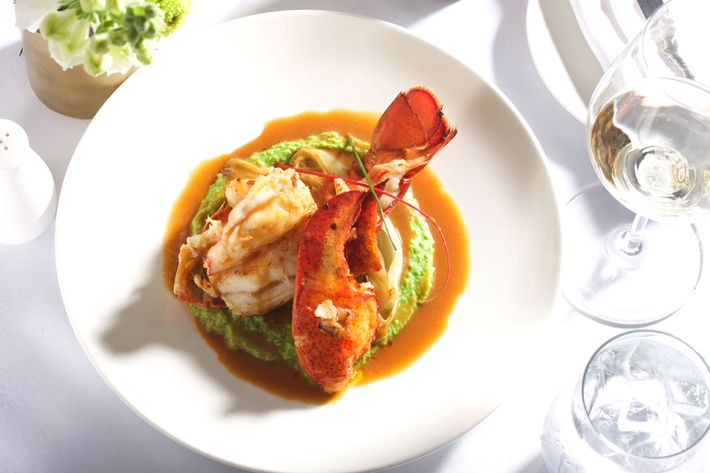 Butter-poached Maine lobster with sweet-pea mousseline, citrus-braised endiv​e, ​white-wine lobster sauce.