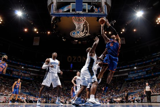 ORLANDO, FL - APRIL 5: Tyson Chandler #6 of the New York Knicks shoots over Glen Davis #11 of the Orlando Magic on April 5, 2012 at Amway Center in Orlando, Florida. NOTE TO USER: User expressly acknowledges and agrees that, by downloading and or using this photograph, User is consenting to the terms and conditions of the Getty Images License Agreement. Mandatory Copyright Notice: Copyright 2012 NBAE  (Photo by Fernando Medina/NBAE via Getty Images)