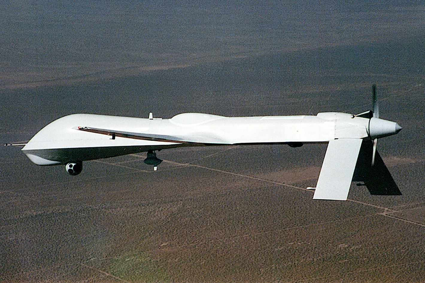 """The MQ """"Predator"""" drone or Unmanned Aerial Vehicle (UAV) is shown in this undated handout photo from the aircraft's manufacturer, General Atomics. General Atomics explains that the previous """"RQ"""" designation for this vehicle has recently been changed to """"MQ"""" to reflect the aircrafts multi-functional capabilities. The new designation moves the Predator from a strictly reconnaissance role, to an ability to carry and fire weapons such as the """"Hellfire"""" missile."""