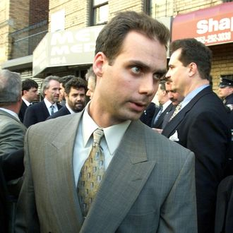 New York City police officer Kenneth Boss makes his way through the crowd from the Bronx Courthouse to address the press 31 March, 1999 in New York. Boss and three other officers have been charged with second degree murder for shooting 41 times and hitting 19 times 04 February 1999 Amadou Diallo, a street vendor from Guinea.
