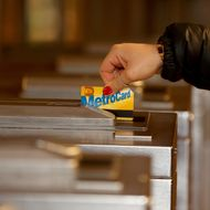 A person swipes a metrocard in New York subway station on January 13, 2014.