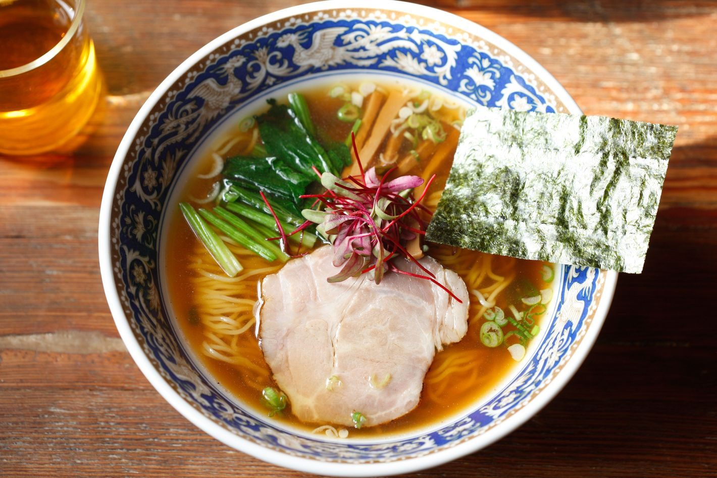 The torigara ramen is made with chashu, menma (pickled bamboo shoots), and spinach.