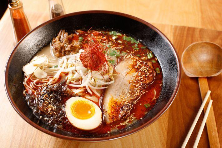 Spicy tonkotsu ramen with pork belly, ground pork, soft-boiled egg, fried garlic, and kikurage mushrooms.