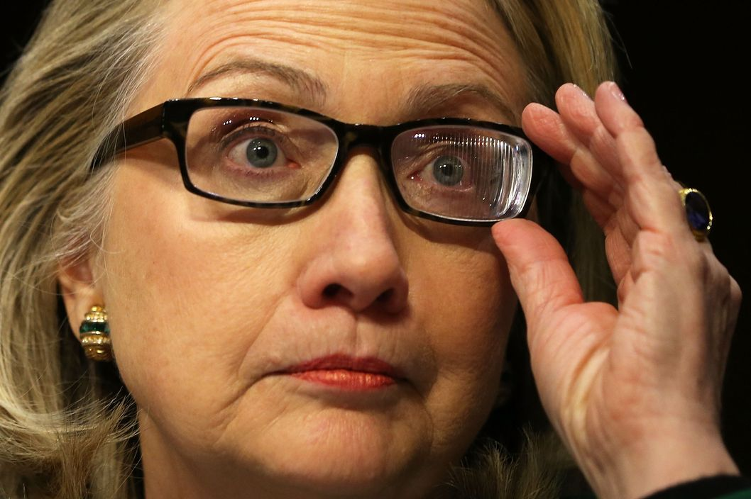 That is not a reflection of the window blinds in Clinton's left lens. It's a Fresnel prism.