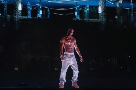 A hologram of deceased rapper Tupac Shakur performs onstage during day 3 of the 2012 Coachella Valley Music & Arts Festival