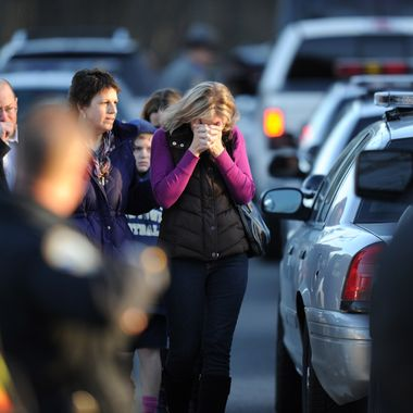 Residents grieve following a shooting December 14, 2012 at Sandy Hook Elementary School on December 14, 2012 in Newtown, Connecticut. At least 26 people, including 20 young children, were killed when a gunman assaulted the school and another body was found dead at a second linked crime scene, police said.  Police spokesman Lieutenant Paul Vance told reporters that the attacker killed 20 children and six adults, including someone that he lived with, at the Sandy Hook Elementary School in Newtown, Connecticut.  The gunman also died at the scene, and a 28th body was found elsewhere.