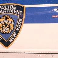 "A New York Police Department emblem reading ""POLICE DEPARTMENT, CITY OF NEW YORK"" is displayed on the side of an NYPD Aviation Unit helicopter in Manhattan."