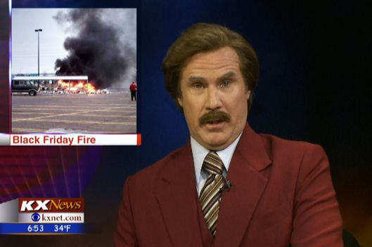 Ron Burgundy (Will Ferrell) participates in the KX News evening broadcast on November 30, 2013 in Bismarck, North Dakota.