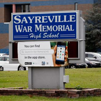 The entrance to Sayreville War Memorial High School is shown Tuesday, Oct. 7, 2014, in Sayreville, N.J. Officials at a school, which has won three sectional titles over the past four years, canceled the football season amid allegations of harassment, intimidation and bullying among players. (AP Photo/Mel Evans)