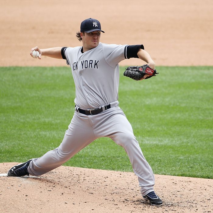 Phil Hughes #65 of the New York Yankees pitches in the fifth inning during the game against the Detroit Tigers