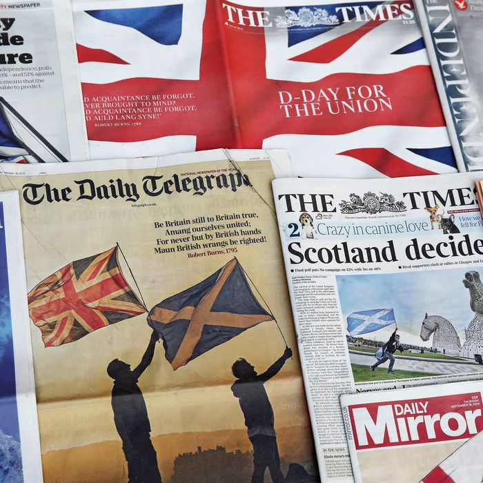 In this photo illustration, a selection of the British National Newspaper front pages are displayed on September 18, 2014 in London, England. After many months of campaigning the people of Scotland today head to the polls to decide the fate of their country. The referendum is too close to call but a Yes vote would see the break-up of the United Kingdom and Scotland would stand as an independent country for the first time since the formation of the Union.