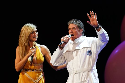 German TV host Heidi Klum and US actor David Hasselhoff, right,  perform on stage during the 2012 MTV European Music Awards show at the Festhalle in Frankfurt, central Germany, Sunday, Nov. 11, 2012.