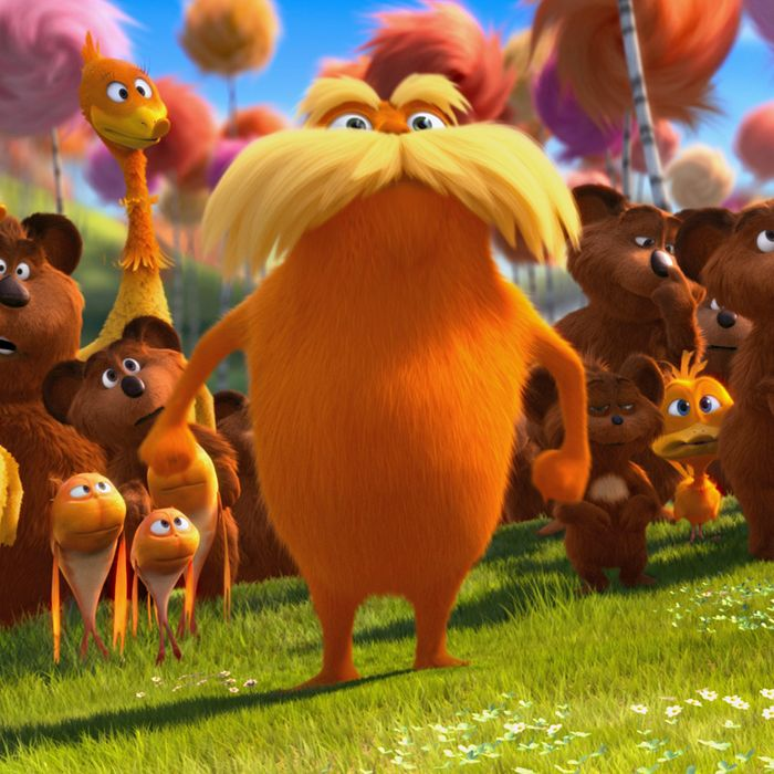 The Lorax (DANNY DEVITO) stands with the Bar-ba-loots, Swomee-Swans and Humming-Fish in