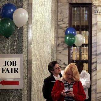 Job seekers wait in line to enter the San Francisco Hirevent job fair at the Hotel Whitcomb on March 27, 2012 in San Francisco, California.