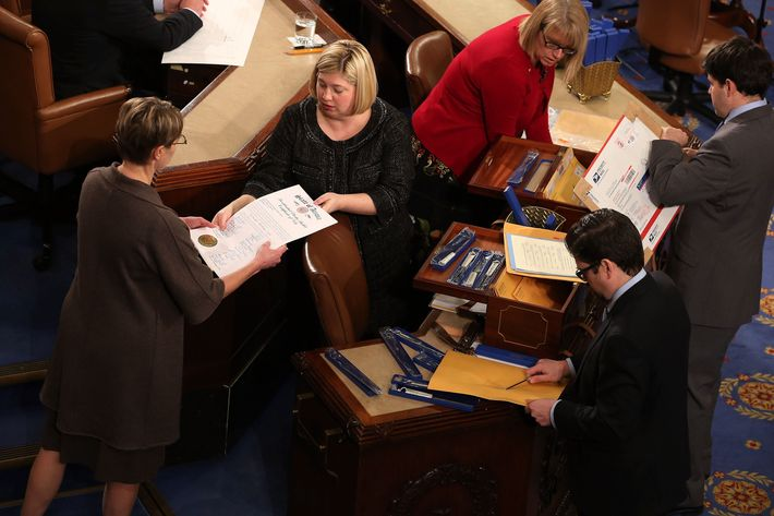 Congressional clerks help unseal and organize the Electorial College votes from the 50 states in the House of Representatives chamber at the U.S. Captiol January 4, 2013 in Washington, DC. The votes were tallied during a joint session of the 113th Congress. President Barack Obama and Biden received 332 votes to be reelected.