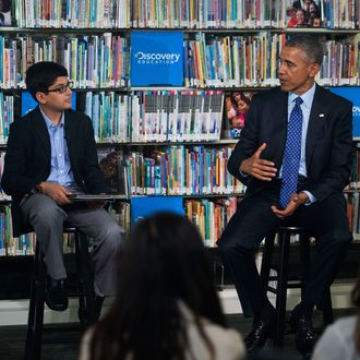 30 Apr 2015, Washington, DC, USA --- US President Barack Obama (R), with student moderator Osman Yaya (L), responds to a question while participating in a