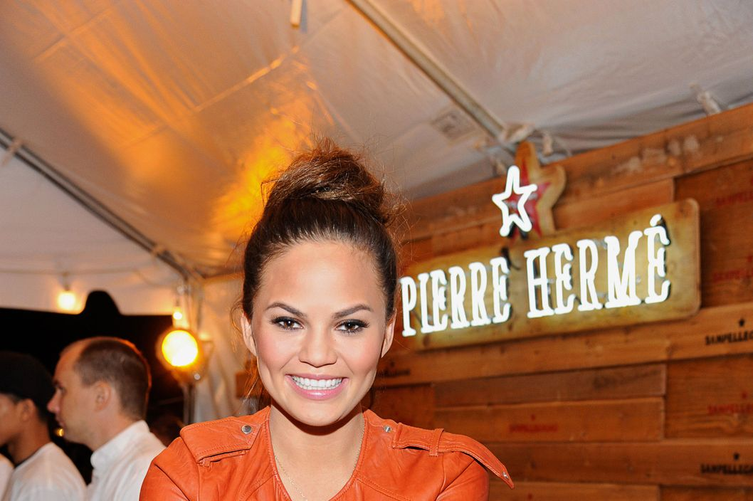 Model Chrissy Teigen attends the SanPellegrino Sparkling Fruit Beverages booth inside Le Grand Fooding NY Campfire Session food & music festival on September 23, 2012 in the Brooklyn borough of New York City.