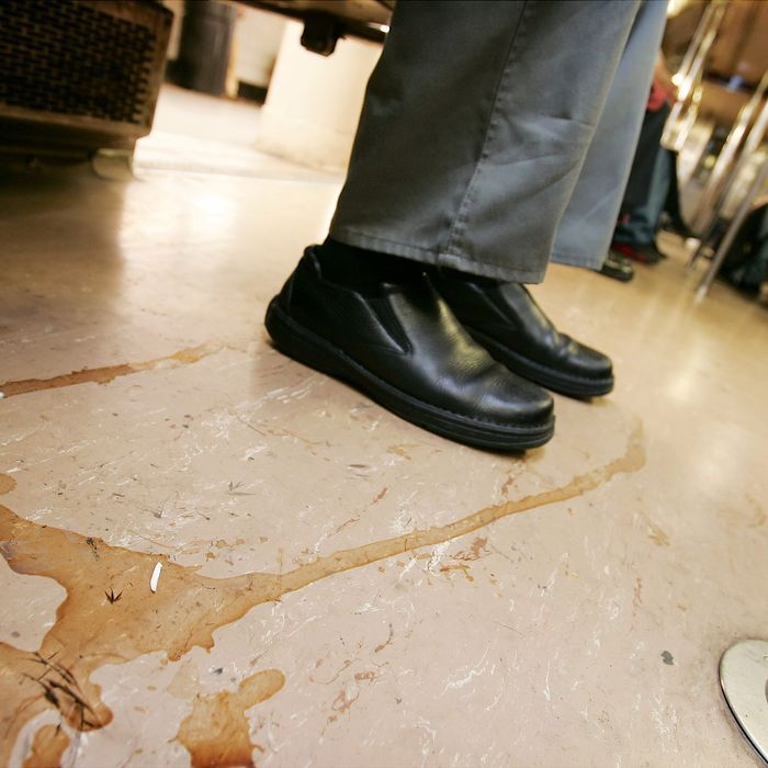 Floor of subway car is filthy as straphangers ride the No. 1/9 subway line through Manhattan.