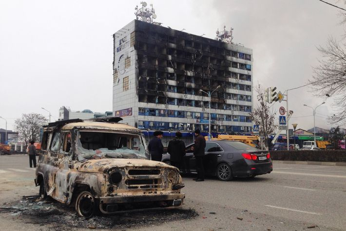 Burnt media building is seen in Grozny capital city of the Chechen Republic, Russia. At least three police officers and seven suspected militants were killed in ongoing clashes that began early Thursday morning in Russias autonomous Republic of Chechnya, authorities said on December 04, 2014. Police said their officers came under attack when they stopped a vehicle of the militants in the Chechen capital Grozny.