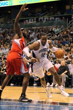 ORLANDO, FL - FEBRUARY 06:  Dwight Howard #12 of the Orlando Magic drives against Reggie Evans #30 of the Los Angeles Clippers during the game at Amway Center on February 6, 2012 in Orlando, Florida.   NOTE TO USER: User expressly acknowledges and agrees that, by downloading and or using this Photograph, user is consenting to the terms and conditions of the Getty Images License Agreement.  (Photo by Sam Greenwood/Getty Images)