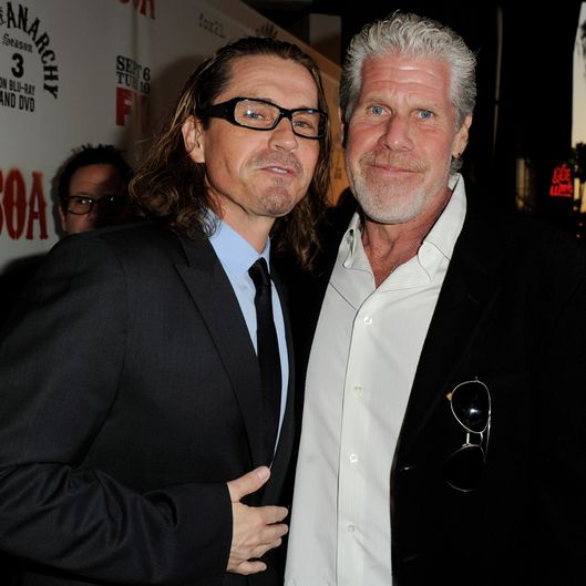 "Executive producer Kurt Sutter (L) and actor Ron Perlman arrive at a screening of FX's ""Sons of Anarchy"" at the Cinerama Dome Theater"