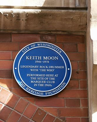 A wall plaque unveiled by British singer Roger Daltrey (unseen) is pictured high on the wall at 90 Wardour Street in London on March 8, 2009, in honour of the late Keith Moon, drummer for the rock band 'The Who', who died in 1978. AFP PHOTO/MAX NASH (Photo credit should read MAX NASH/AFP/Getty Images)