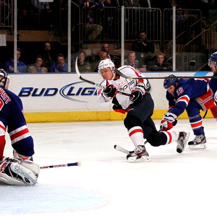 Alexander Semin #28 of the Washington Capitals takes a shot against Henrik Lundqvist #30 of the New York Rangers