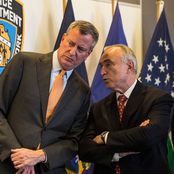 NEW YORK, NY - DECEMBER 04: New York City Mayor Bill de Blasio and New York Police Department (NYPD) Commissioner Bill Bratton review new police guidelines that will be taught to police officers at the Police Academy on December 4, 2014 in the College Point neighborhood of the Queens borough of in New York City. The new police guidelines come on the heels of numerous national incidences where white police officers have killed black men. (Photo by Andrew Burton/Getty Images)