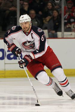 CHICAGO, IL - JANUARY 10:  Rick Nash #61 of the Columbus Blue Jackets controls the puck against the Chicago Blackhawks at the United Center on January 10, 2012 in Chicago, Illinois. The Blackhawks defeated the Blue Jackets 5-2.  (Photo by Jonathan Daniel/Getty Images) *** Local Caption *** Rick Nash