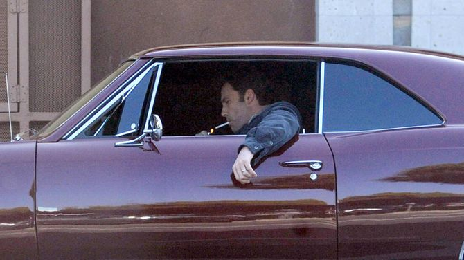 Ben Affleck relaxes in LA as he puffs on a cigarette in his 1966 Chevy Chevelle