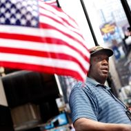 Duane Jackson sets up his sales stand while talking to reporters in Times Square in New York, Sunday, May 2, 2010.