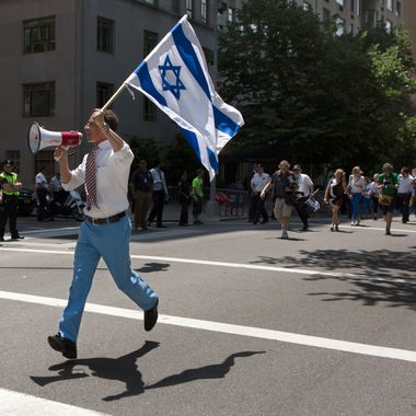 "New York City mayoral candidate and former U.S. Rep. Anthony Weiner waves an Israeli flag as he marches up New York's Fifth Avenue in the Israel Day Parade Sunday June 2, 2013. Weiner has been absent from the annual parade since 2011, when he became entangled in a Twitter scandal involving a below-the-belt photo. ""It's great, if feels great, this is home to me,"" he said. ""I'm, kind of like a thoroughbred in a stable, ready to hit the starting line."" (AP Photo/Cassandra Giraldo)"