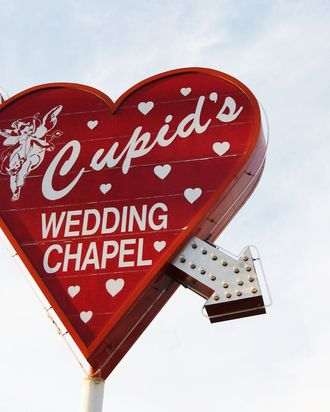 LAS VEGAS, NV - MAY 30: Cupid's Wedding Chapel sign is seen on display on May 30, 2002 in Las Vegas, Nevada. (Photo by Robert Mora/Getty Images)