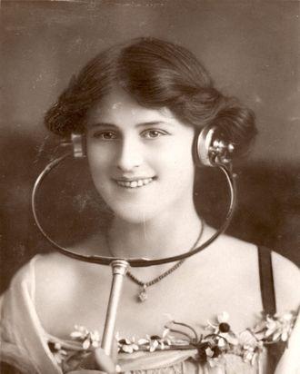 British music-hall star Zena Dare models a pair of turn-of-the-century headphones.