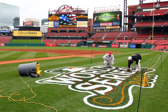 ST LOUIS, MO - OCTOBER 18:  Workers paint a 2011 World Series logo on the field at Busch Stadium on October 18, 2011 in St Louis, Missouri.The Texas Rangers will take on the St. Louis Cardinals in Game One of the 2011 World Series on October 19.  (Photo by Dilip Vishwanat/Getty Images)