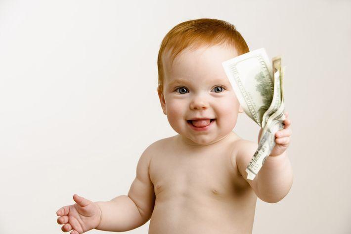 Baby holding wad of money