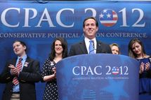Presidential candidate and former Pennsylvania senator Rick Santorum arrives on stage to speak during an address to the 39th Conservative Political Action Committee February 10, 2012 in Washington, DC.