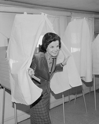 11 Dec 1979, San Francisco, California, USA --- Original caption: San Francisco: Incumbent Mayor Dianne Feinstein emerges from voting booth after casting her ballot December 11th, 1979, in a runoff election for mayor of San Francisco, between herself and supervisor Quentin Kopp. In the first round of the municipal elections November 6th, 1979, Feinstein got 42% of the vote to Kopp's 40% with the remainder going to a gay Realtor & minor candidates. --- Image by © Bettmann/CORBIS