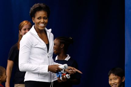 "NEW YORK, NY - SEPTEMBER 09:  First lady Michelle Obama laughs as she plays the Wii during the Let's Move! tennis clinic during Day Twelve of the 2011 U.S. Open at the USTA Billie Jean King National Tennis Center on September 9, 2011 in the Flushing neighborhood of the Queens borough of New York City. ""Let's Move!"" is an initiave by the first lady that highlights the importance of physical activity for kids.  (Photo by Mike Stobe/Getty Images for USTA)"