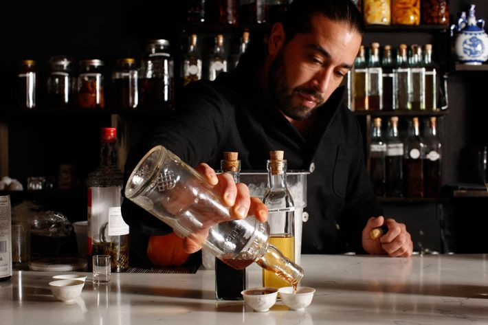 Salicetti pours some of his house-infused baijiu.