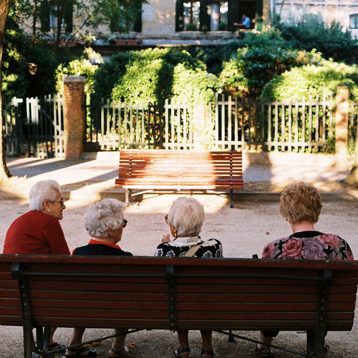 Four women on a bench.