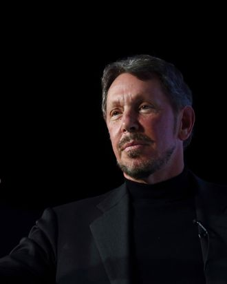 Larry Ellison, chief executive officer of Oracle Corp., gestures as he makes a speech at the New Economy Summit 2014 in Tokyo, Japan, on Wednesday, April 9, 2014.