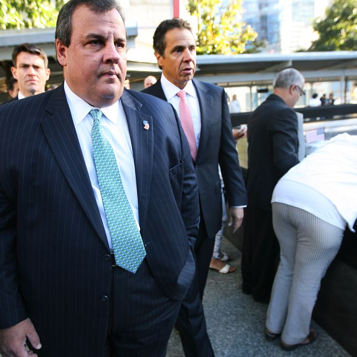 New Jersey Gov. Chris Christie (L) and New York Gov. Andrew Cuomo walk after seeing Hector Garcia (2R) as he watches over his wife Carmen as she hugs the inscribed name of her daughter Marilyn who was killed in the north tower of the WTC during observances for the eleventh anniversary of the terrorist attacks on lower Manhattan at the World Trade Center site September 11, 2012 in New York City. The nation is commemorating the eleventh anniversary of the September 11, 2001 attacks which resulted in the deaths of nearly 3,000 people after two hijacked planes crashed into the World Trade Center, one into the Pentagon in Arlington, Virginia and one crash landed in Shanksville, Pennsylvania.