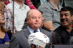 Head Coach Bruce Boudreau and Alex Ovechkin #8 of the Washington Capitals looks on from the bench during NHL game action against the Toronto Maple Leafs November 19, 2011 at Air Canada Centre in Toronto, Ontario, Canada.