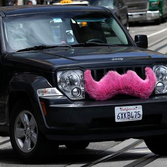 SAN FRANCISCO, CA - JUNE 12: A Lyft car drives along Powell Street on June 12, 2014 in San Francisco, California. The California Public Utilities Commission is cracking down on ride sharing companies like Lyft, Uber and Sidecar by issuing a warning that they could lose their ability to operate within the state if they are caught dropping off or picking up passengers at airports in California. (Photo by Justin Sullivan/Getty Images)
