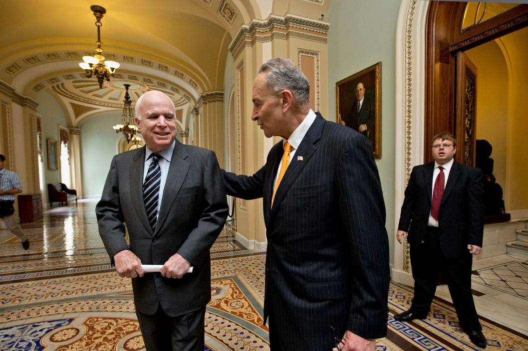 27 Jun 2013, Washington, DC, USA --- Sen. John McCain, R-Ariz., left, and Sen. Charles Schumer, D-N.Y., center, two of the authors of the immigration reform bill crafted by the Senate's bipartisan Gang of Eight, confer on Capitol Hill in Washington, Thursday, June 27, 2013, prior to the final vote. The historic legislation would dramatically remake the U.S. immigration system and require a tough new focus on border security. (AP Photo/J. Scott Applewhite) --- Image by © J. Scott Applewhite/ /AP/Corbis