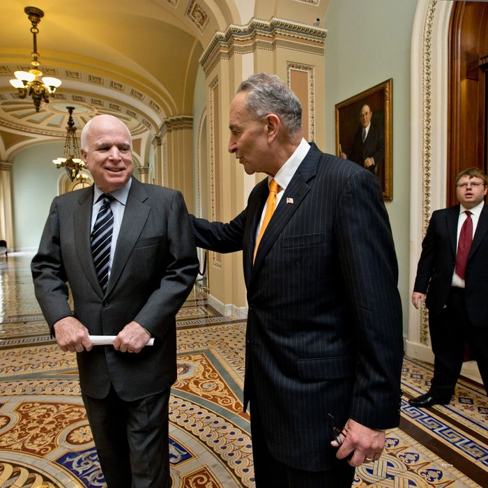 Sen. John McCain, R-Ariz., left, and Sen. Charles Schumer, D-N.Y., center, two of the authors of the immigration reform bill crafted by the Senate's bipartisan Gang of Eight, confer on Capitol Hill in Washington, Thursday, June 27, 2013, prior to the final vote. The historic legislation would dramatically remake the U.S. immigration system and require a tough new focus on border security.