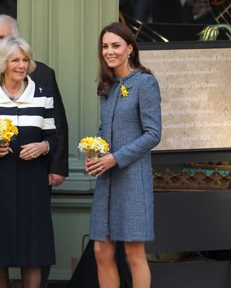 Queen Elizabeth II, Camilla, Duchess Of Cornwall and Catherine, Duchess Of Cambridge visit Fortnum and Mason store on Piccadilly. The Royal Trio smiled as they walked out the shop to loud cheers from the large crowd that gathered outside the shop. Catherine Middleton wore a blue coat by Italian label Missoni and shoes by Rupert Sanderson. Catherine Middleton The Duchess Of Cambridge also sported two daffodils on her lapel in honour of St Davids day. The Queen Elizabeth II also unveiled a plaque to commemorate the regeneration of Piccadilly outside the Fortnum & Mason Store