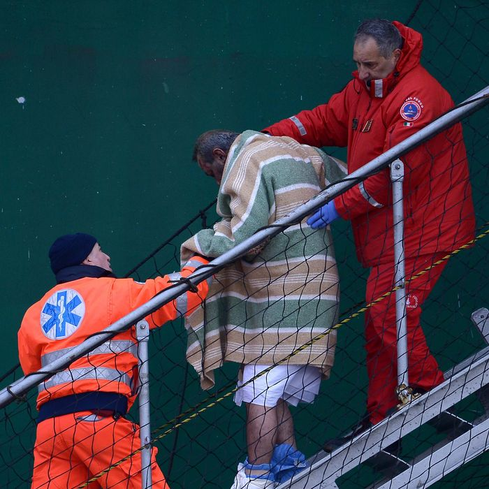 A wounded passenger (C) among 49 survivors evacuated from the burning ferry